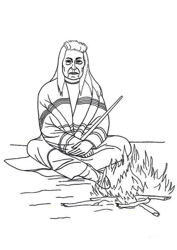 chief of native american sitting in front of fire coloring page